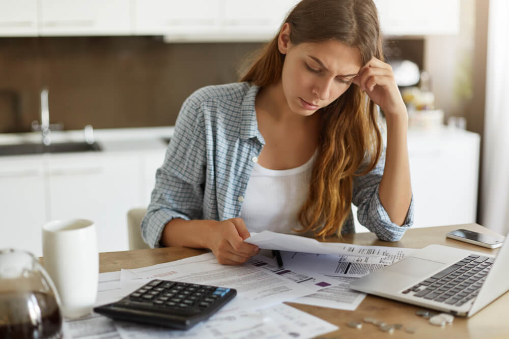 woman trying to figure out how to pay her sober living bills